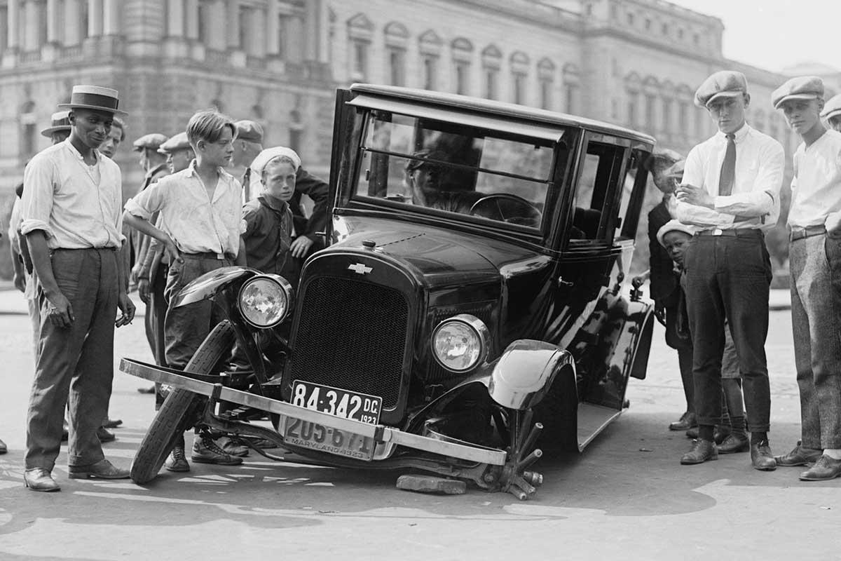 People Staring At A Broken Car